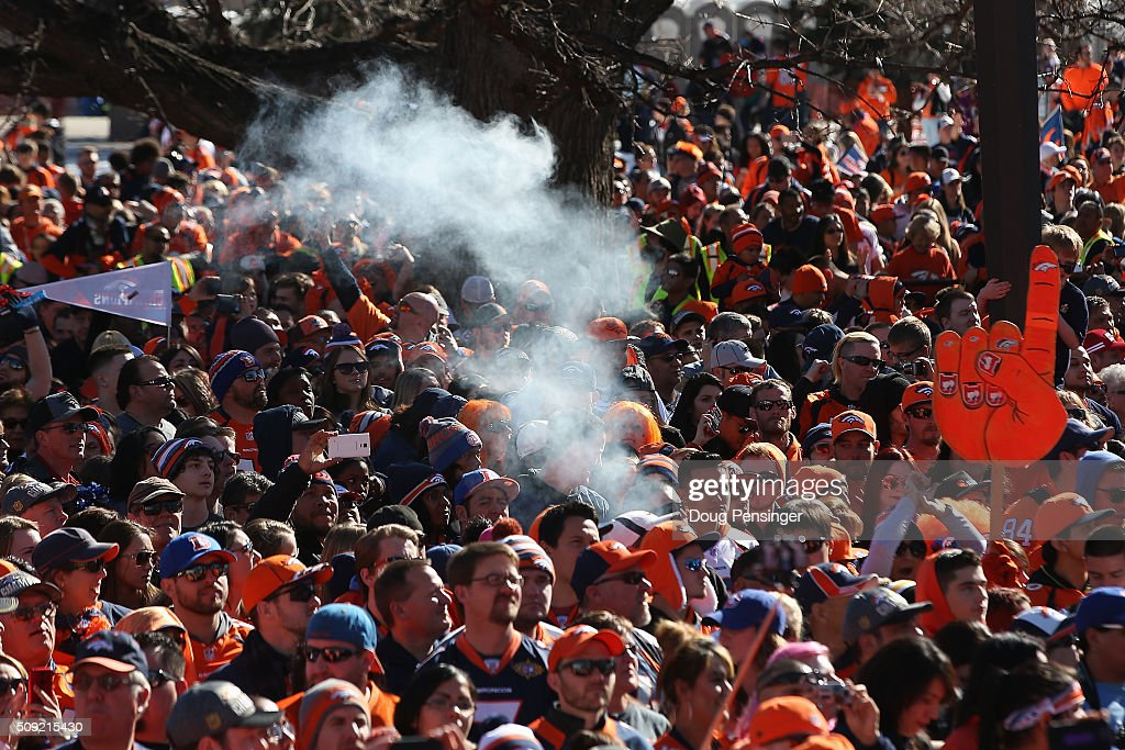 Smoke wafts above the crowd as fans gather in Civic Center Park in front of the Colorado State Capitol to celebrate the Super Bowl 50 Champion Denver Broncos at a rally on the steps of the Denver City and County Building on February 8, 2016 in Denver, Colorado. The Broncos defeated the Carolina Pathers 24-10 in Super Bowl 50.