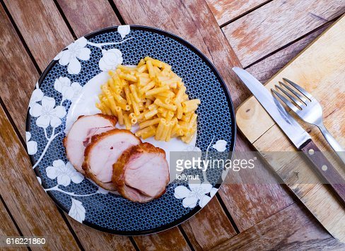 Smoked chicken breast sliced with cheese macaroni : Stock Photo