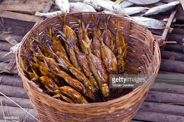 Smoked fish in rattan basket