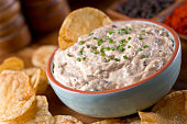 A bowl of delicious homemade smoked mackerel dip with caramelized onions and smoked paprika.