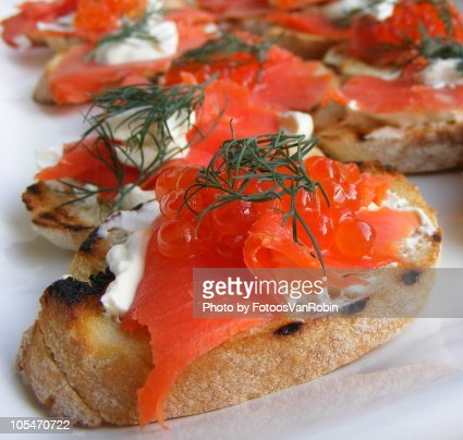 Smoked salmon canape stock photo getty images for Canape garnishes
