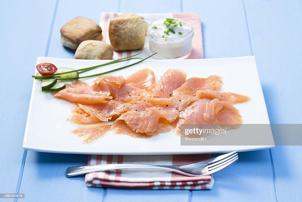 Smoked salmon on plate with napkin, close up