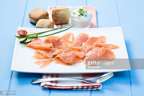Smoked salmon on plate with napkin, close up