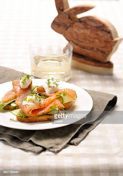 smoked salmon on toast boiled quail eggs topped with cress