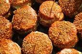 Smoked salmon patties covered with sesame seeds lie on display at a stand at the International Green Week agricultural trade fair on January 16 2015...