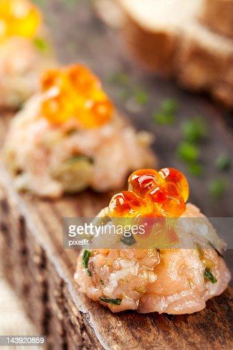 Smoked salmon tartare with wild caviar : Stock Photo