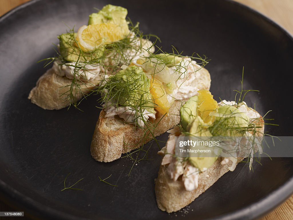Smoked trout toasts with relish : Stock Photo