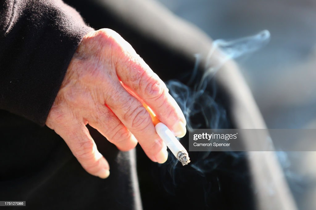A smoker holds a cigarette on August 1, 2013 in Sydney, Australia. In a plan announced today, the government will increase the excise on tobacco by 12.5 per cent annually over the next four years, raising over AUD$5 billion. The hike is estimated to increase the cost of cigarettes by AUD$5 by 2016, and is the first increase in the tobacco excise since 2010.