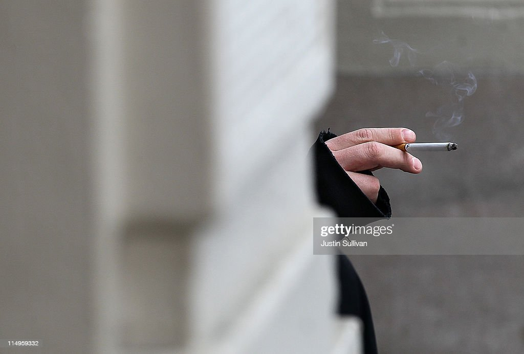 A smoker holds a cigarette on May 31, 2011 in San Francisco, California. Since 1987, the World Health Organization has celebrated 'World No Tobacco Day' to raise awareness to the health risks associated with smoking tobacco. Smoking is the second biggest cause of death globally and is responsible for the death of one in ten adults worldwide.