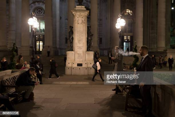 Smokers enjoy a moment of solitude amid the bustle of Cornhill in the Square Mile the heart of the capital's historical financial district on 2nd...