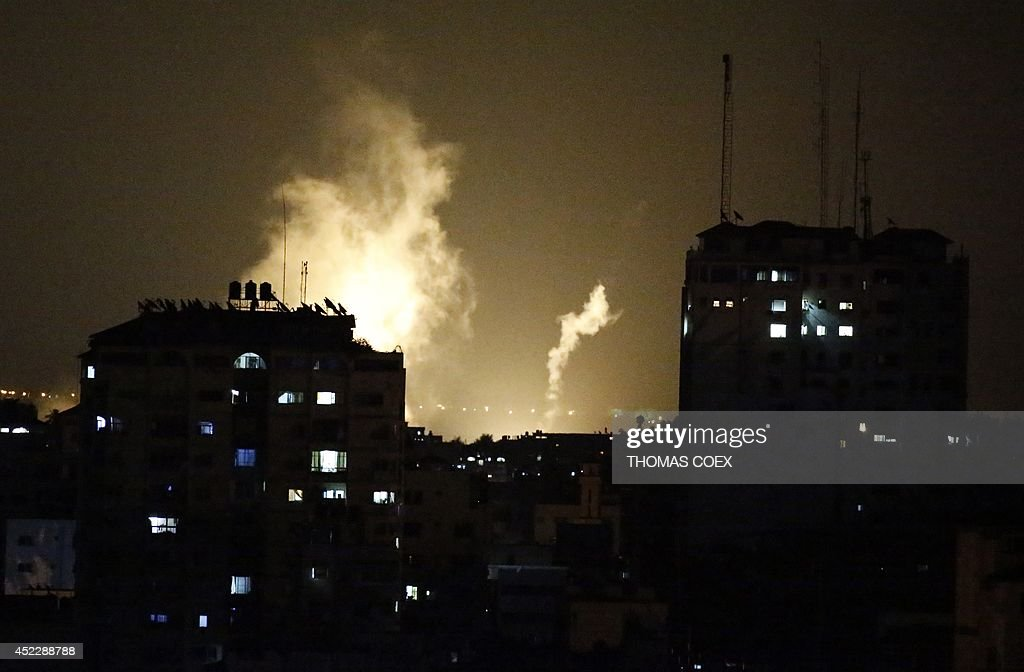 Smokes billow from Palestinian buildings following an Israeli strike in Gaza City on July 17 2014 Israel launched a ground operation in Gaza late...