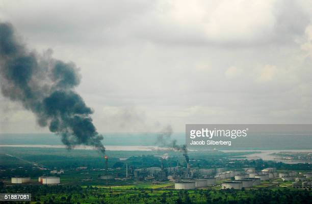 Smokes comes from the Eleme Refinery October 12 2004 in Port Harcourt Nigeria This is one of only two working oil refineries in Nigeria A member of...