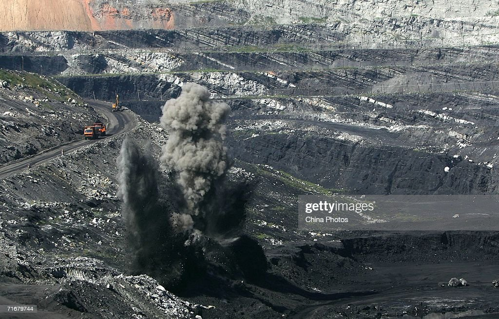 Smokes rise from coal seams after a blasting in an open pit coal mine on August 19, 2006 in Chifeng of Inner Mongolia Autonomous Region, China. Pingzhuang Coal Groups Company, including six open pit coal mines, produces 10 million tons per year. Reportedly, in the first four months of this year, China's coal consumption rose by 13.8 percent over the same period of last year, and coal price is expected to go up steadily with the factors of environment, safety and resources included in the cost of coal production.