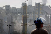 Smokes rises from a damaged areas after an explosion and fire at the Exxon Mobil Corp Torrance refinery in Los Angeles California US on Wednesday Feb...
