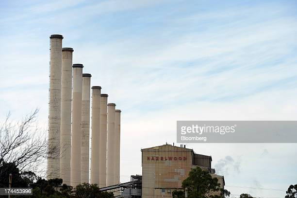 Smokestacks stand next to the main processing building of GDF Suez Australian Energy's Hazelwood coalfired power station in Morwell Australia on...