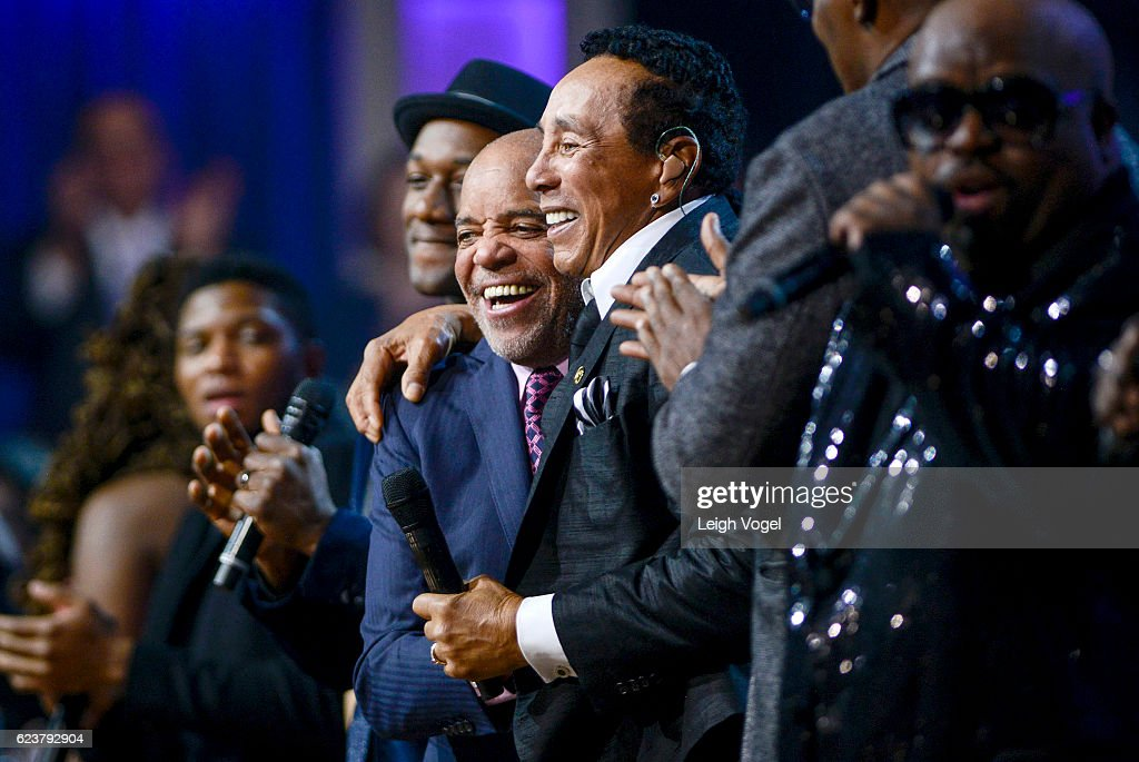 Smokey Robinson and Berry Gordy hug on stage during the 2016 Gershwin Prize For Popular Song at DAR Constitution Hall on November 16, 2016 in Washington, DC.