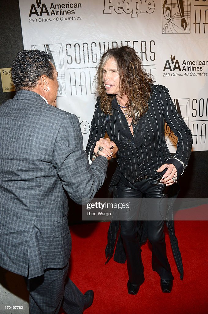 <a gi-track='captionPersonalityLinkClicked' href=/galleries/search?phrase=Smokey+Robinson&family=editorial&specificpeople=210698 ng-click='$event.stopPropagation()'>Smokey Robinson</a> (L) and Honoree <a gi-track='captionPersonalityLinkClicked' href=/galleries/search?phrase=Steven+Tyler+-+Musician&family=editorial&specificpeople=202080 ng-click='$event.stopPropagation()'>Steven Tyler</a> attend the Songwriters Hall of Fame 44th Annual Induction and Awards Dinner at the New York Marriott Marquis on June 13, 2013 in New York City.