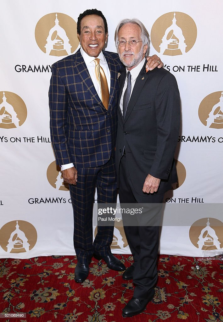 Smokey Robinson and Neil Portnow President and CEO of The Recording Academy pose for a photo at the GRAMMYs on The Hill Dinner at The Hamilton on...