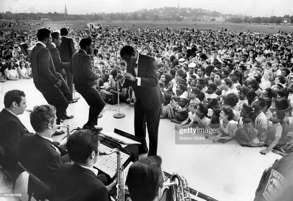 Smokey Robinson and The Miracles perform before a crowd at Carter Field in Boston for a Summerthing event on Jul. 8, 1968.