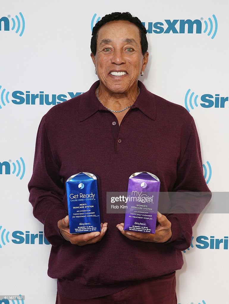 Smokey Robinson holds two of his new skincare products at SiriusXM Studio on October 19, 2016 in New York City.