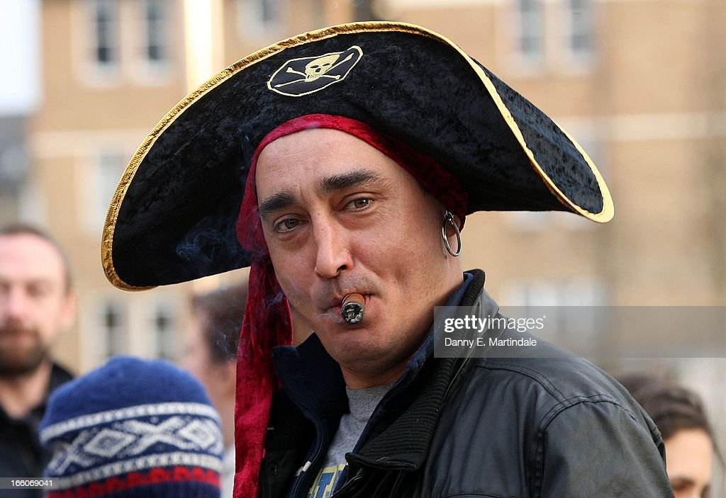 A smoking a cigar and wearing a pirate's hat joins others as they celebrate the death of former British Prime Minister Margaret Thatcher in Brixton on April 8, 2013 in London, England. Lady Thatcher has died this morning following a stroke aged 87. Margaret Thatcher was the first female British Prime Minster and governed the UK from 1979 to 1990. She led the UK through some turbulent years and contentious issues including the Falklands War, the miners' strike and the Poll Tax riots.