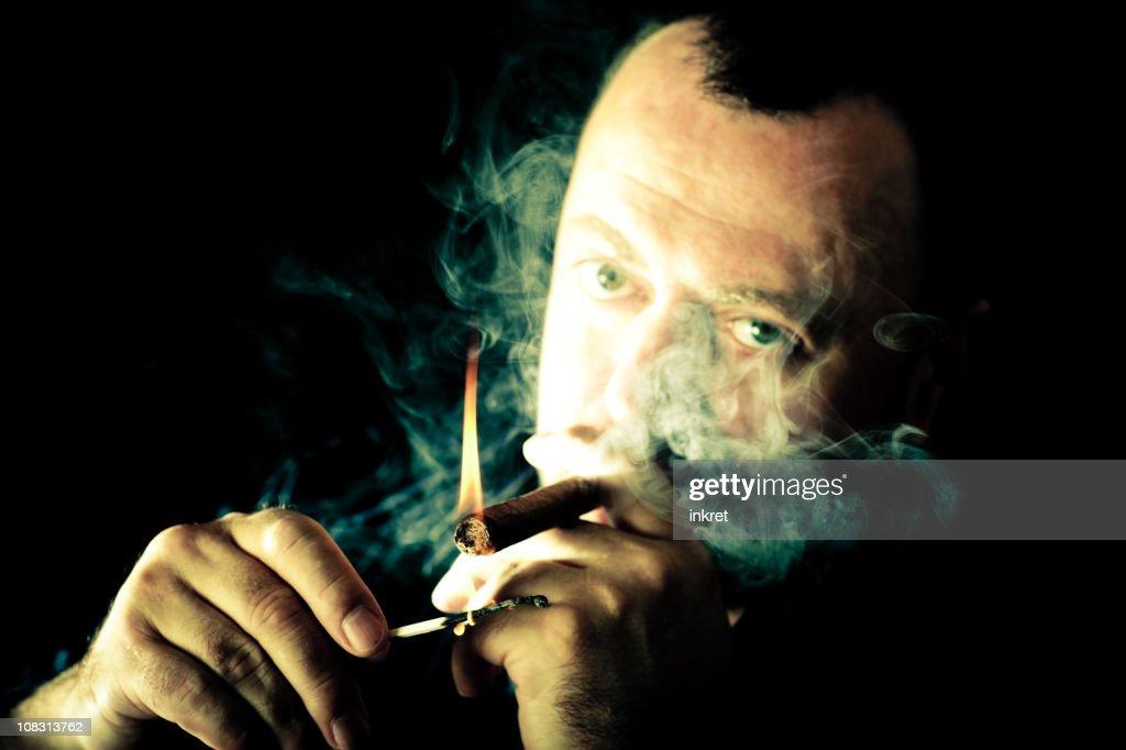 Smoking a cigar : Stock Photo