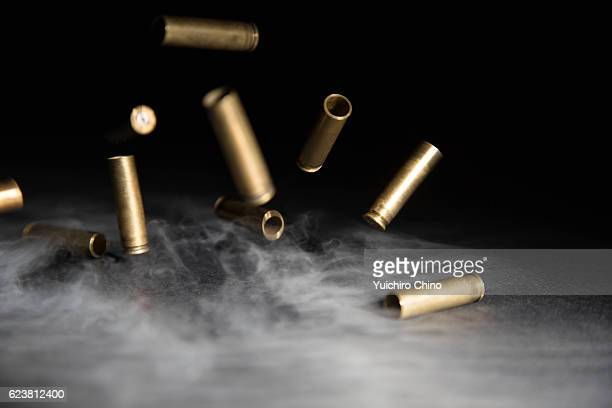 Smoking Bullets Falling on Ground