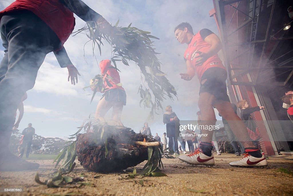 A smoking ceremony takes place for the players as they head out onto oval for training during an Essendon Bombers AFL media opportunity at True Value Solar Centre on May 27, 2016 in Melbourne, Australia.