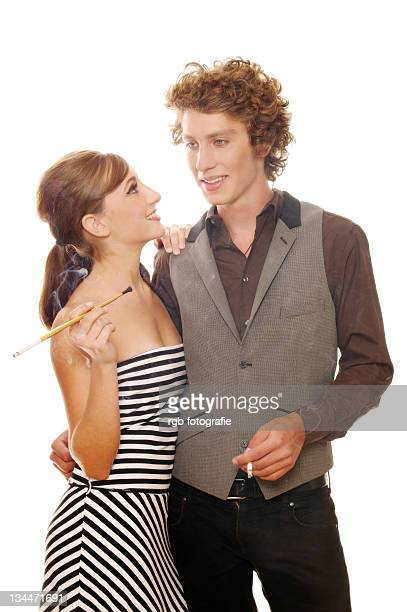 Smoking couple in a 60s look