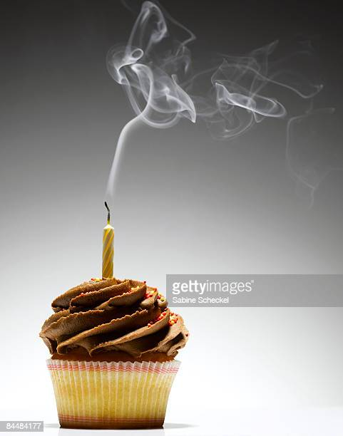 smoking extinguished candle on cupcake