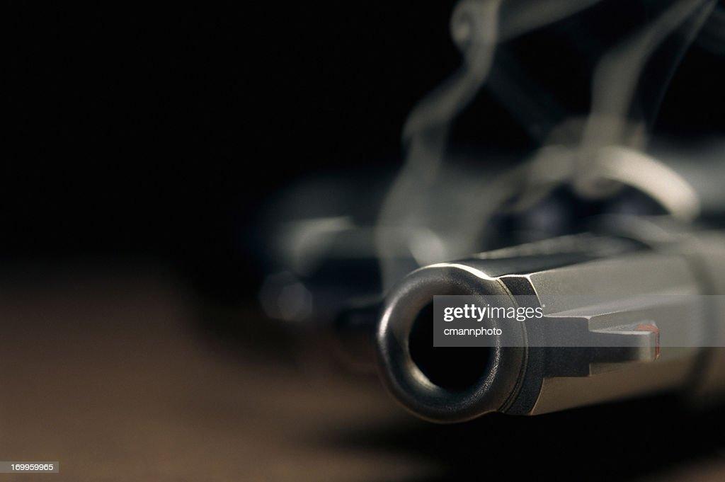 Smoking gun lying on the floor, revolver : Stock Photo