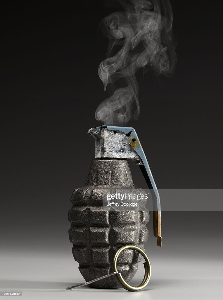 Smoking Hand Grenade with Pin Pulled : Stock Photo
