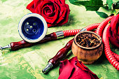 East hookah with flower aroma for relax.Shisha hookah.Smoking a hookah