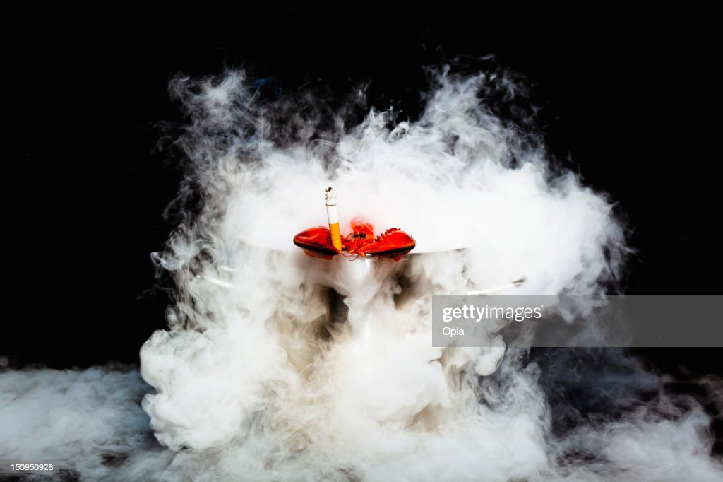 Smoking lobster in boiling pan : Stock Photo