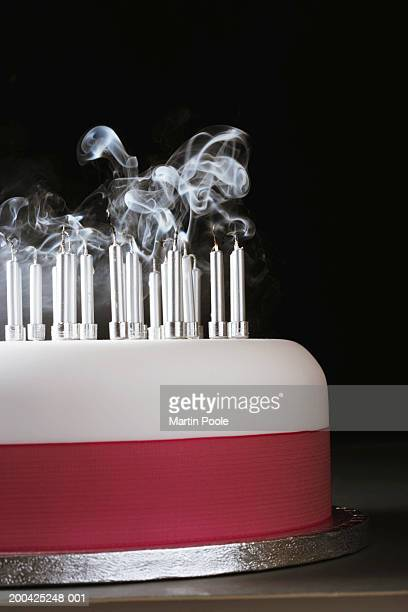 Smoking rising from extinguished candles on cake, close-up