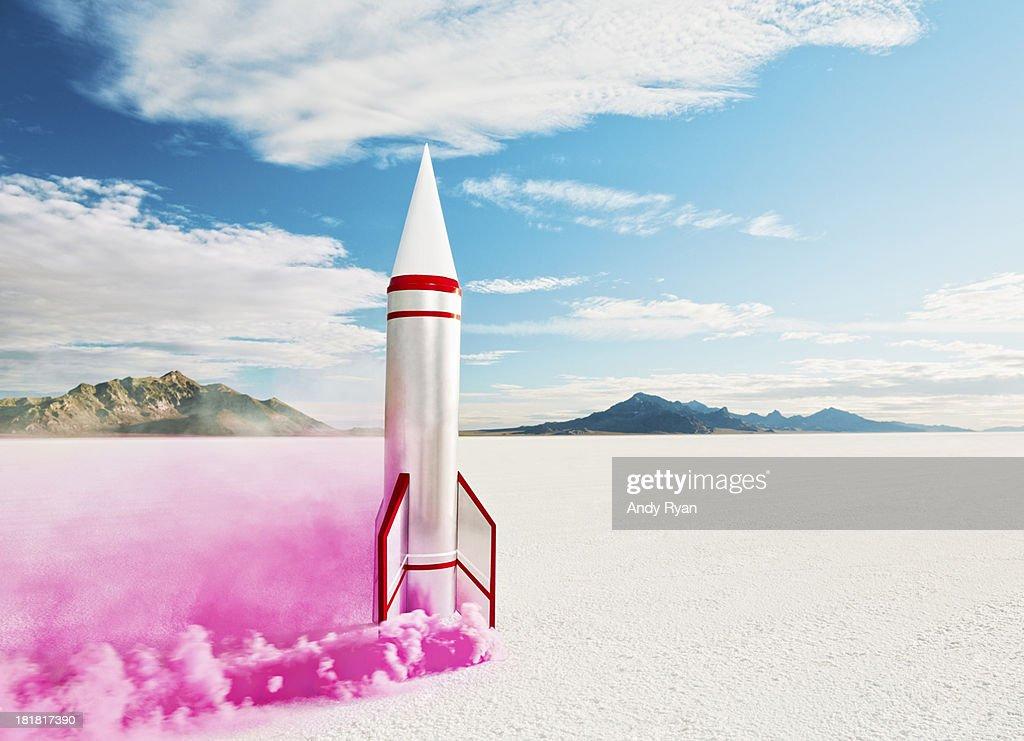 Smoking rocket on salt flats.