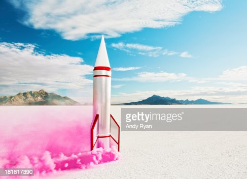 Smoking rocket on salt flats.