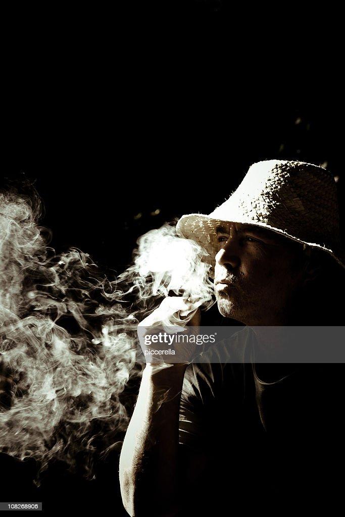 Smoking Wise Man : Stock Photo