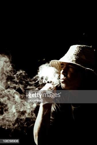 Smoking Wise Man : Stock Photo