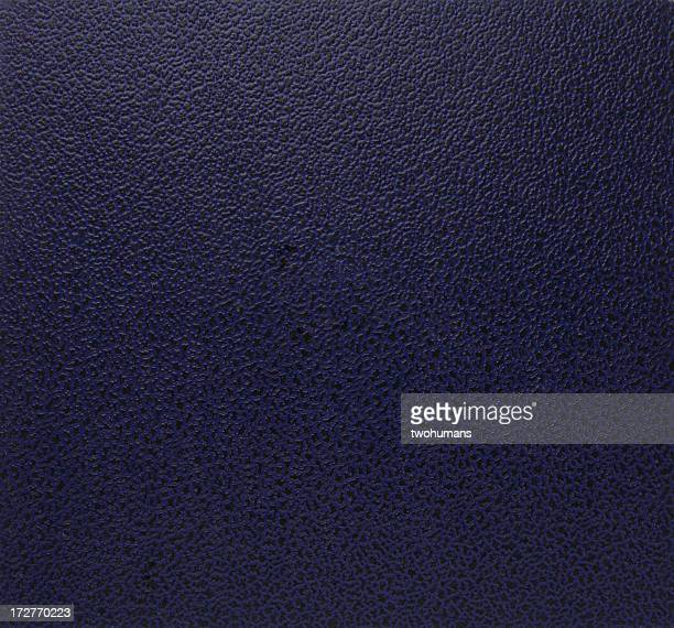 Smooth leather on a plain background