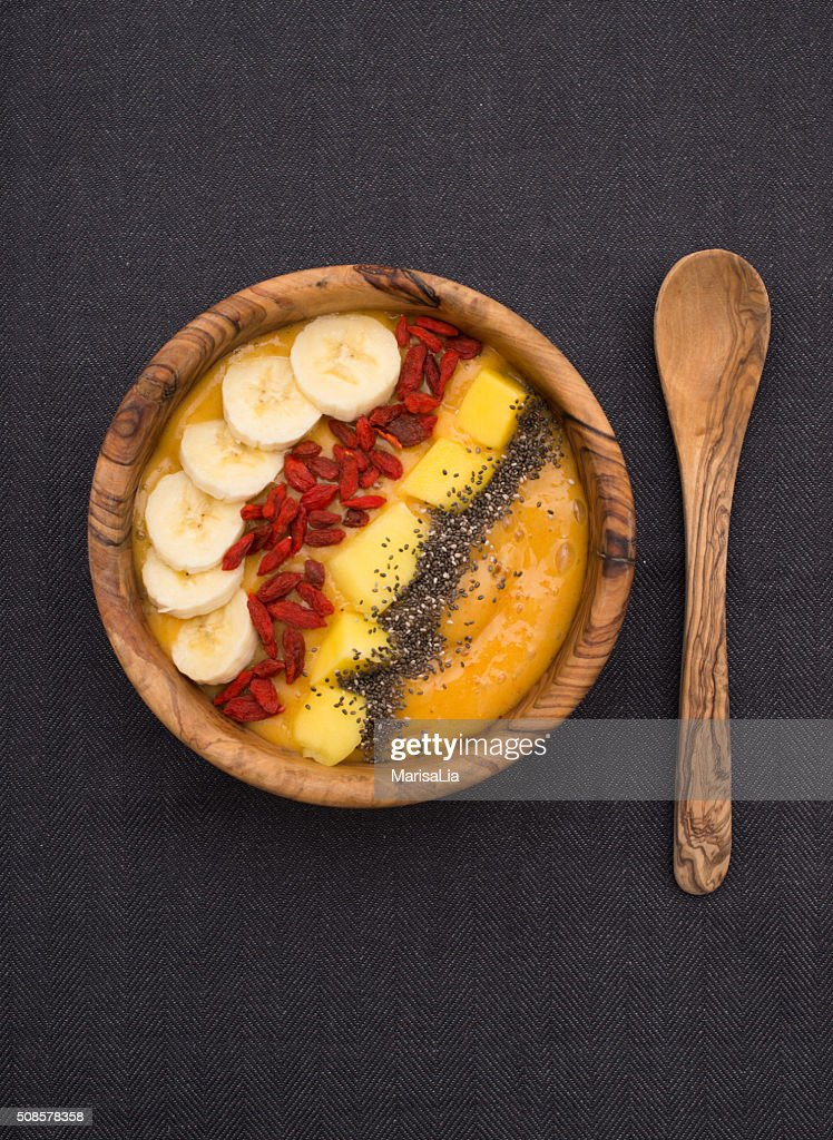 smoothie bowl with goji, banana, mango and chia seeds : Stock Photo