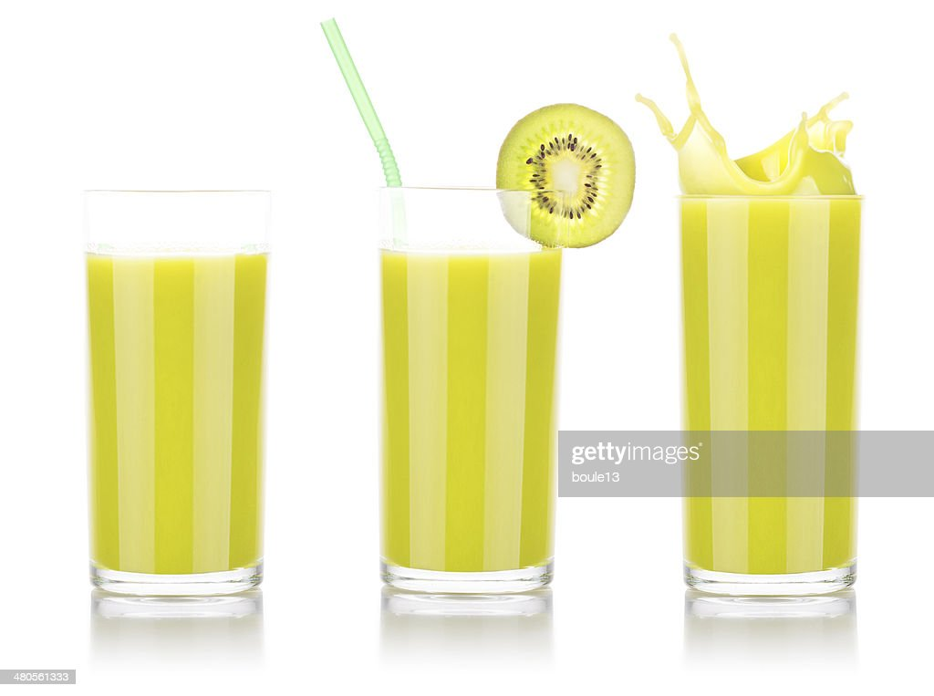 Smoothies of kiwi in glass with splash : Stock Photo