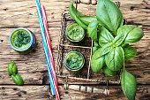 Freshly blended green basil smoothie in glass jar