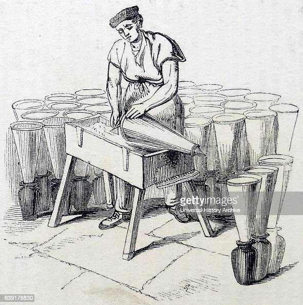 Smoothing off the tops of moulds filled with sugar and setting them aside to harden for a couple of days Sugar refinery Whitechapel London 1841