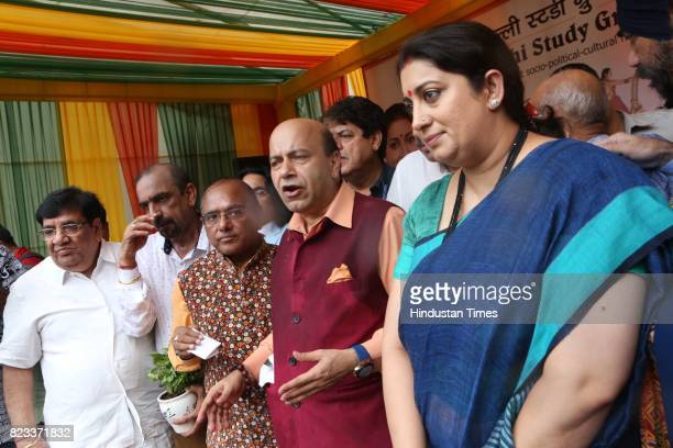 Smriti Irani Minister of Textiles Information and Broadcasting with former BJP MLA Vijay Jolly and others during the Teej festival celebrations...