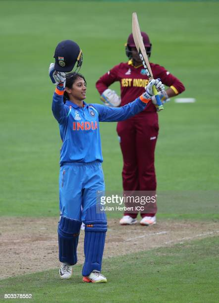 Smriti Mandhana celebrates her century during The ICC Women's World Cup 2017 match betwen The West Indies and India at The County Ground on June 29...