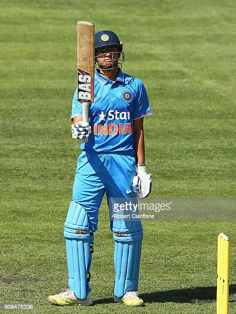 Smriti Mandhana of India celebrates after reaching her half century during game two of the women's one day international series between Australia and...