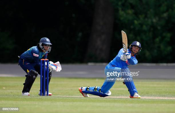 Smriti Mandhana of India hits out during The ICC Women's World Cup warm up match between India and Sri Lanka at Queens Park on June 21 2017 in...