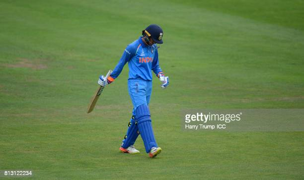 Smriti Mandhana of India walks off after being dismissed during the ICC Women's World Cup 2017 match between Australia and India at The County Ground...