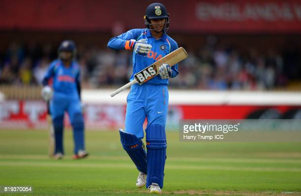 Smriti Mandhana of India walks off after being dismissed during the ICC Women's World Cup 2017 match between Australia and India at The 3aaa County...